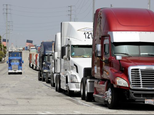 There's a wait list of 8 months to receive new semi-trucks as manufacturers work through a massive backlog of 300,000 orders