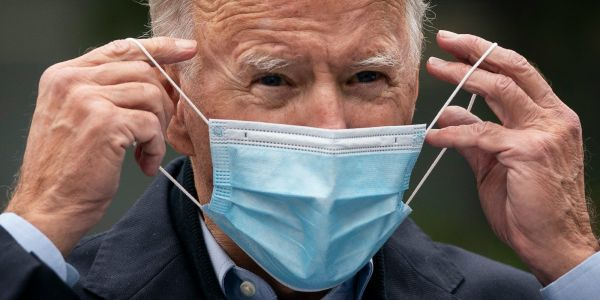 More than 70 percent of Americans back Biden's pandemic response, but many are unhappy with the economy, poll finds