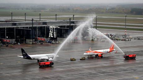 WATCH: Planes complete inaugural landings as 'laughing stock' Berlin airport finally takes off
