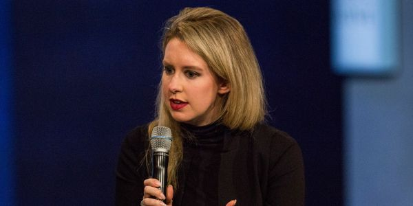 Leaked video shows Theranos employees playing the video game they created where you shoot at the reporter who exposed the startup's problems