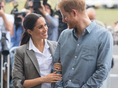 Prince Harry held Meghan Markle's hand behind his back with both of his hands, taking their PDA to a whole new level
