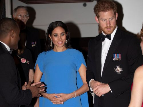 Meghan Markle has been cradling her baby bump on the royal tour, and people are loving it