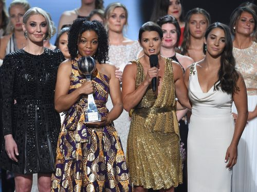 Aly Raisman and 140 victims of Larry Nassar stood on stage together to receive the ESPYs Arthur Ashe Courage Award