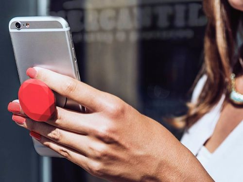 A giant knob you can stick on the back of your phone is taking off with celebrities - and it's on track to sell 30 million this year
