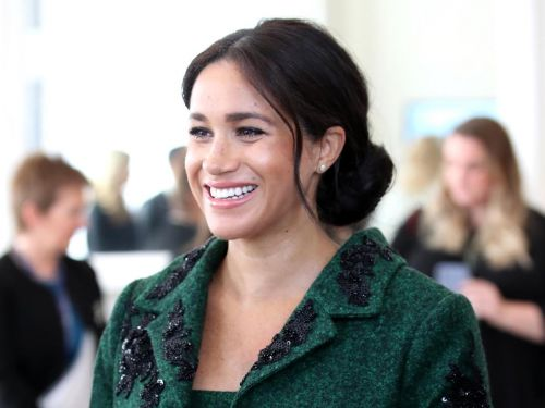 Meghan Markle gave a nod to her Canadian roots in a green Erdem coat on Commonwealth Day