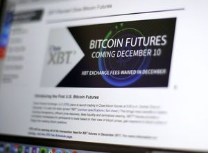 The Latest: Bitcoin futures end 1st day 20 pct higher