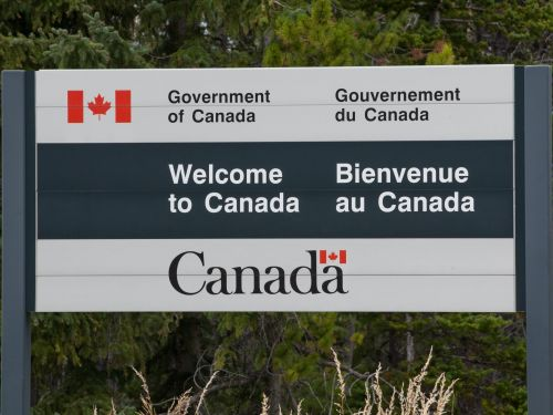 Canadians are flocking to US border cities to take advantage of a travel loophole - and it's creating lucrative opportunities on both sides of the closed border