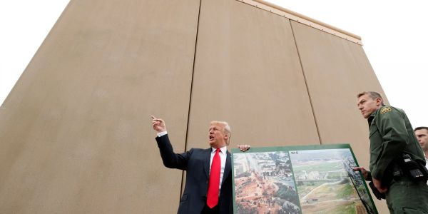A majority of Americans oppose building Trump's wall, but 83% support giving Dreamers citizenship