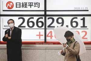 Asian shares mostly rise after Dow crests 30,000 points