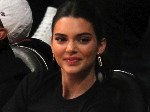 Kendall Jenner changed her shirt in the middle of a basketball game, taking courtside fashion to a new level