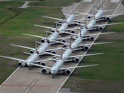 Incredible satellite photos show parked planes sitting on runways at airports in the US and Europe, as COVID-19 puts a near stop to global air travel