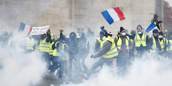 Who are the 'Yellow Vests' protesting across France and rioting in Paris, and what do they want from Macron?