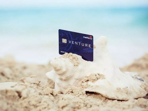 The Capital One Venture card comes with valuable travel benefits - we break down whether they are worth a $95 annual fee