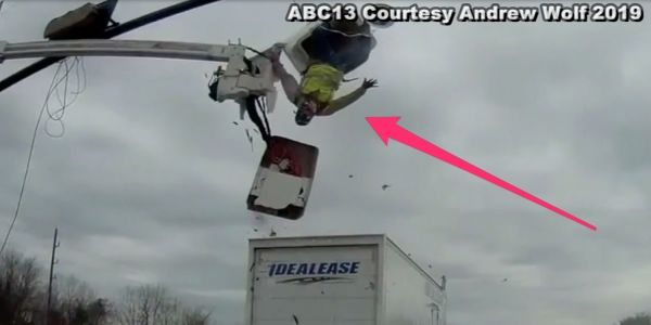 Video shows the moment a big-rig truck slammed into a worker who was suspended above the road repairing a traffic signal