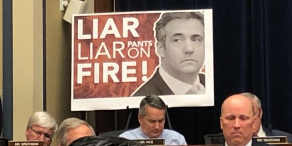 """""""Liar, liar, pants on fire!"""": Republicans bring out posters to mock Michael Cohen during his congressional testimony"""