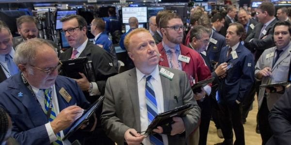 US futures and European stocks slip as concerns over economic recovery surface, while robust China GDP lifts Asian markets