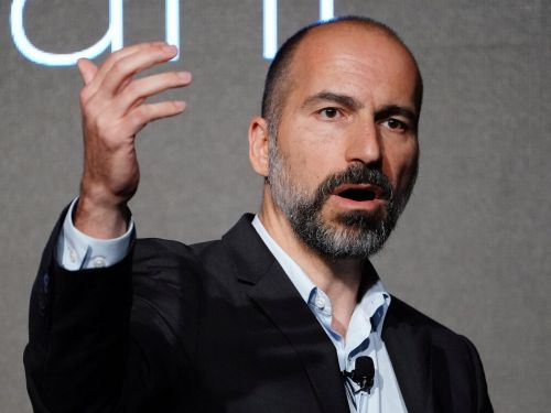 Uber CEO Dara Khosrowshahi says gig economy companies should be required to establish 'benefits funds' for workers instead of treating them as full-time employees