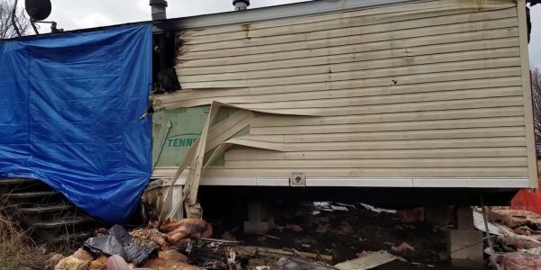A 9-year-old has been charged with murdering 5 people in a mobile home fire