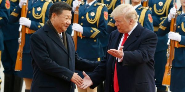 Trump says China is 'actively trying to impact and change our election' by targeting US farmers in the trade war