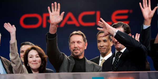 Oracle revoked job offers for some people in the UK, blaming a hiring freeze. Yet it says it's both hiring and still restructuring
