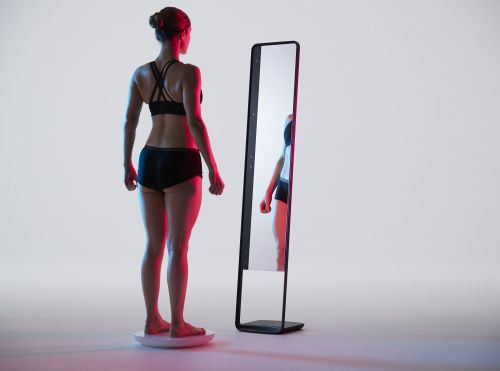 These entrepreneurs invented a futuristic 'magic mirror' to take on the bathroom scale - and investors say its groundbreaking tech could transform the future of fitness