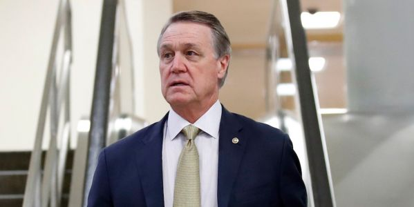 Sen. David Perdue was filmed reportedly taking a cellphone from a college student who was questioning him about voter suppression in Georgia