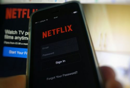 Netflix reports record quarter for new subscribers, but shares fall on earnings miss