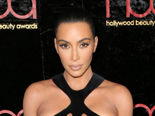 Kim Kardashian wore a vintage 'naked' dress that paired daring cutouts with a thigh-high slit