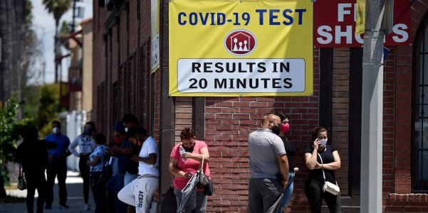 People are waiting on long lines for coronavirus tests ahead of the Thanksgiving holiday