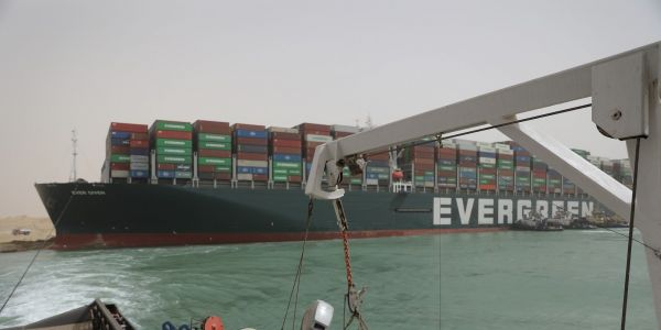 2 experts explain why the company whose ship blocked the Suez Canal has seen its stock surge 28% since the incident started