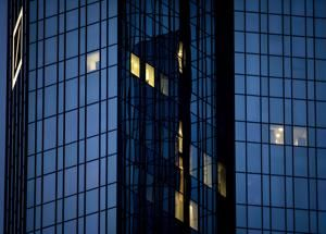 Deutsche Bank makes profit on cost cuts, trading income