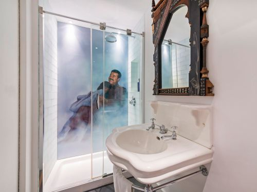 See inside the London home of a Hollywood film director, complete with a vault and a mural of Chairman Mao - and it's available to rent for £35,000 a month