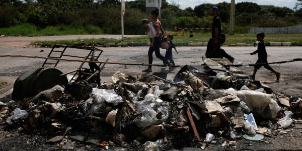 Venezuela's mass exodus has sparked violence, and countries are sending in more troops to deal with it
