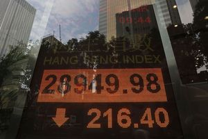 Global stocks mixed as investors await US tax deal