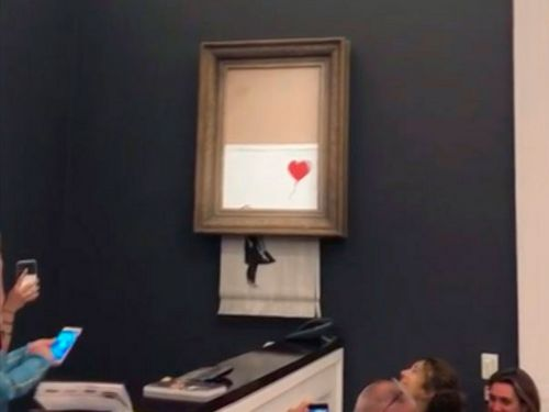 The buyer of the $1.4 million Banksy painting that shredded itself has decided to keep her purchase