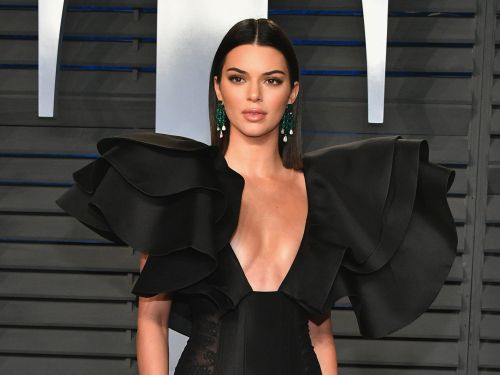Kendall Jenner wore a yellow minidress with 'naked' heels that look almost invisible