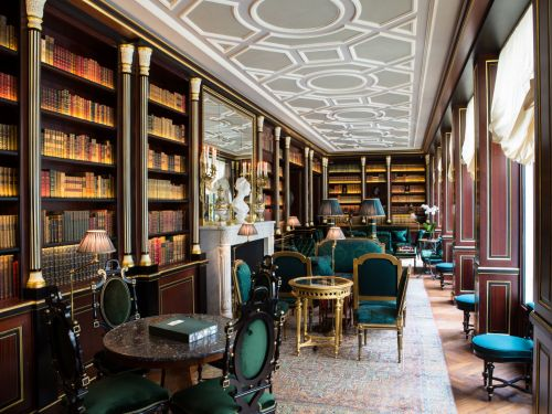 Take a look inside the best hotel in Europe, a boutique hotel in the heart of Paris with personal butlers, a hidden smoking room, and views of the Eiffel Tower