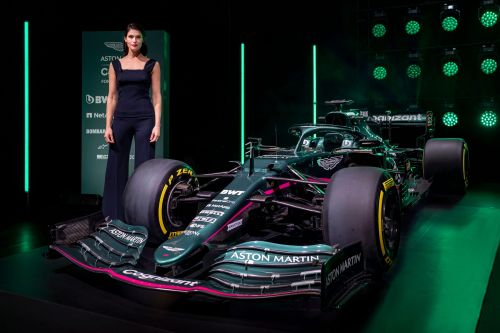Luxury carmaker Aston Martin unveiled its first new Formula 1 car in more than 60 years with the help of Tom Brady and Daniel Craig. Take a look at the AMR21