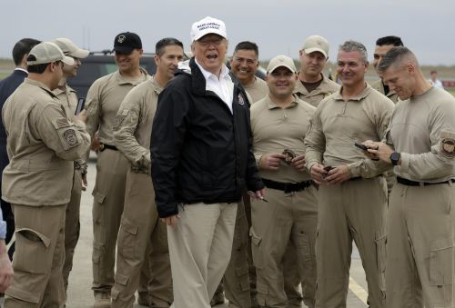 Trump posed with Border Patrol. In the meantime, 2 agents are suing the government over the shutdown