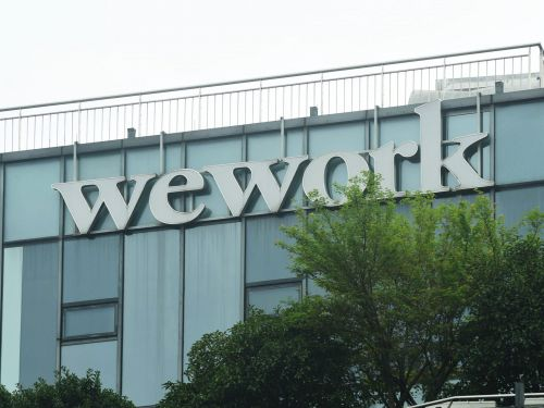 WeWork promises it will be profitable by the end of 2021. But with so much uncertainty over returning to the office, experts think the projection 'feels a bit aggressive.'