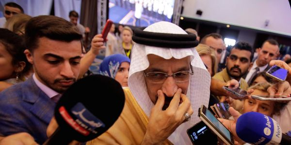 Oil surges after OPEC and Russia agree to production cut