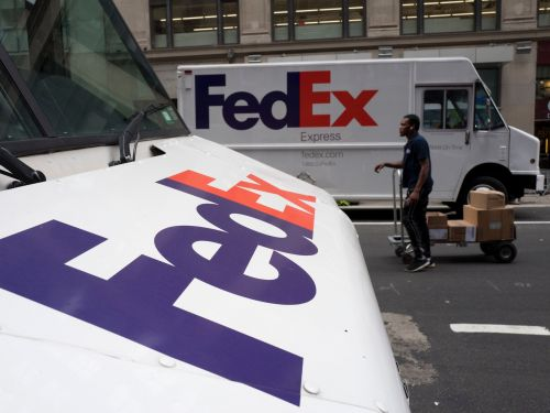 The internet is obsessed with a FedEx employee who cruised through Manhattan on a delivery cart - but FedEx says the speed-meister broke company standards