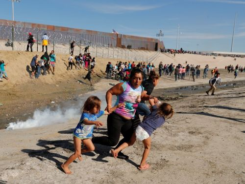 Backlash erupts after the Trump administration fires tear gas at migrants in clash at the US-Mexico border