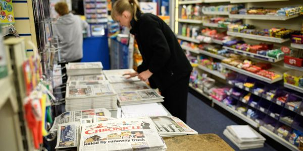 Local newspaper giant Gatehouse Media is quietly laying off journalists across the country after a $30 million acquisition