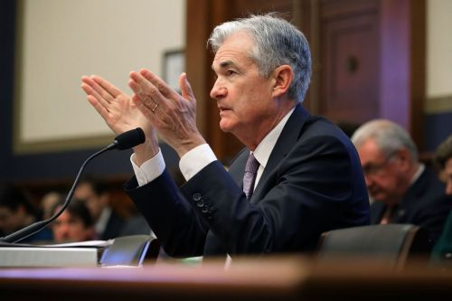 Bank stocks surge after the Federal Reserve raises rates