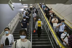 The Latest: Tokyo sees most new virus infections since April