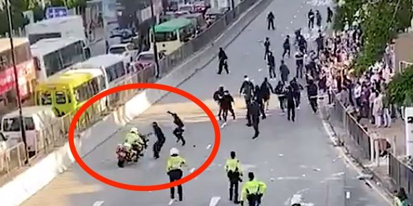 Video shows Hong Kong police officer ramming into protesters with a motorcycle, on day of violence that saw another protester get shot