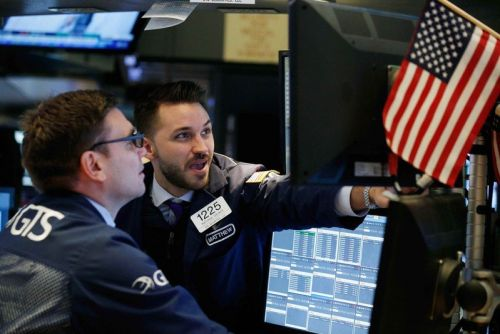 Stocks reverse overnight losses after the disappointing jobs report bolsters expectations for a less aggressive Fed