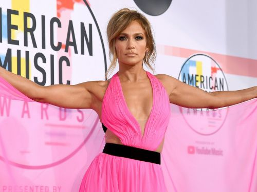 Jennifer Lopez made a bold statement in a Barbie pink gown with cutouts on the red carpet