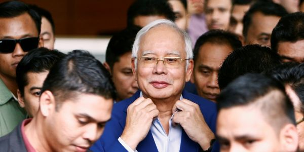 Police found $28.6 million-worth of cash sitting in an empty apartment linked to Malaysia's former prime minister Najib Razak